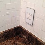 Tamper-Resistant GFCI Outlet with Matching Wall Plate by Legrand
